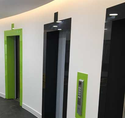 Glass Splashbacks Surrounding Lifts